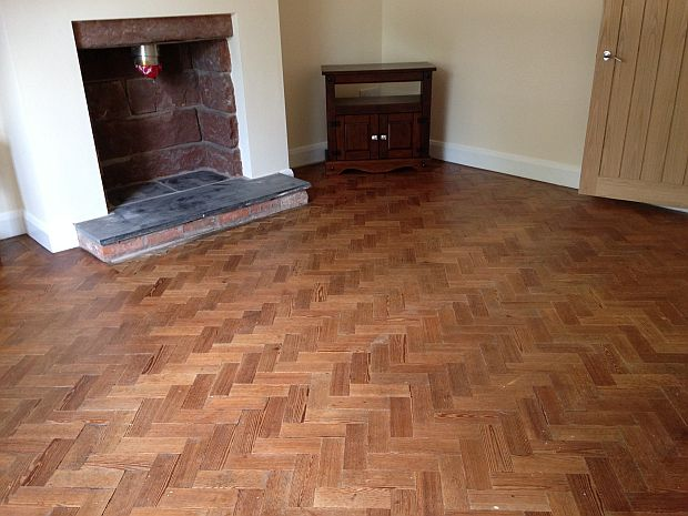 Parquet floor after cleaning with unique, no-sanding, process and sealing